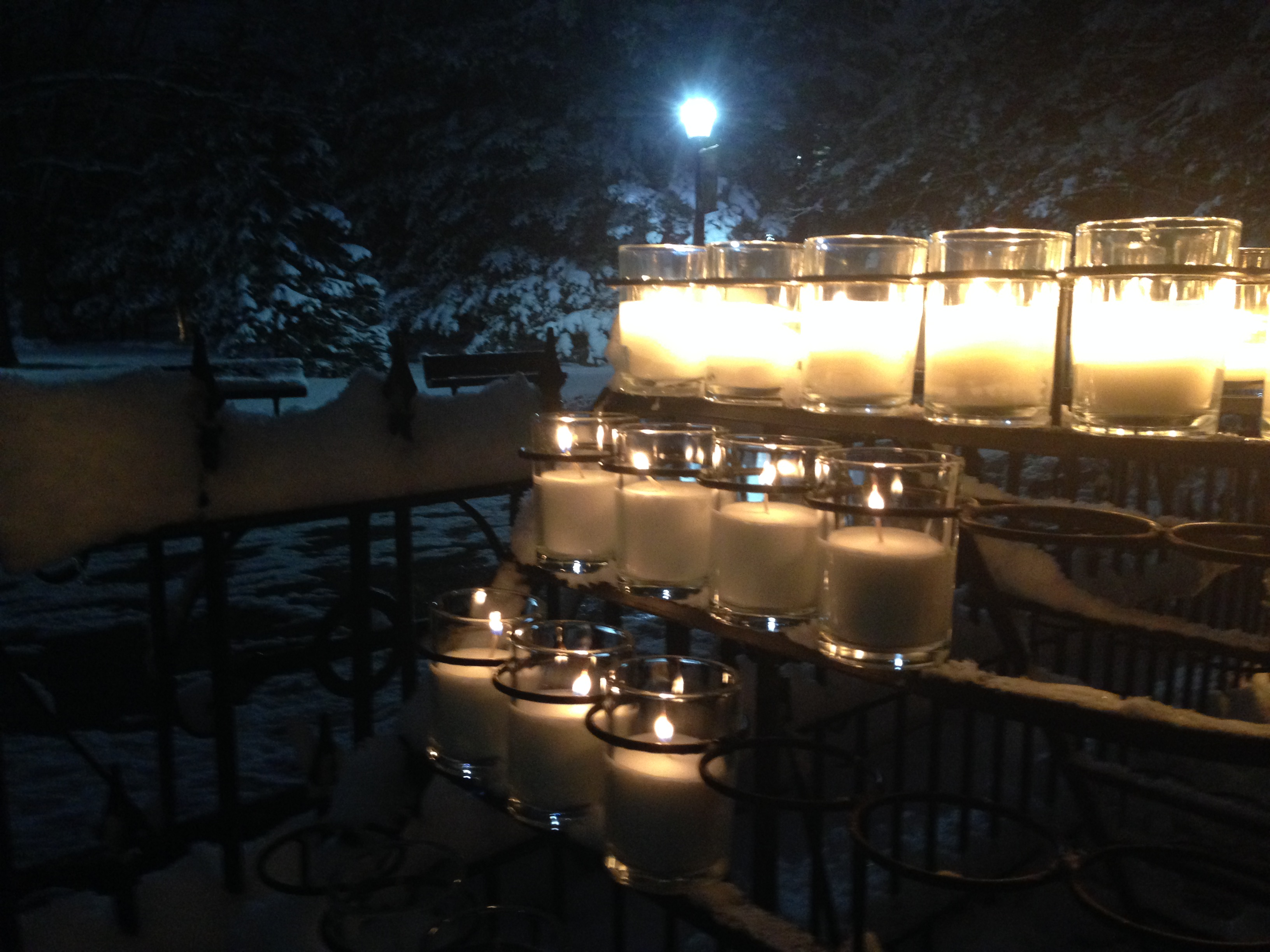 candles lit at the grotto this week for family and friends